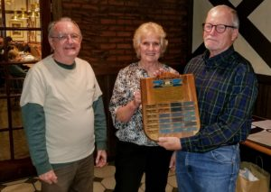 Larry Crain and Vesma Grinfelds present the Holmsten Award to Bradley Fritts (at right).